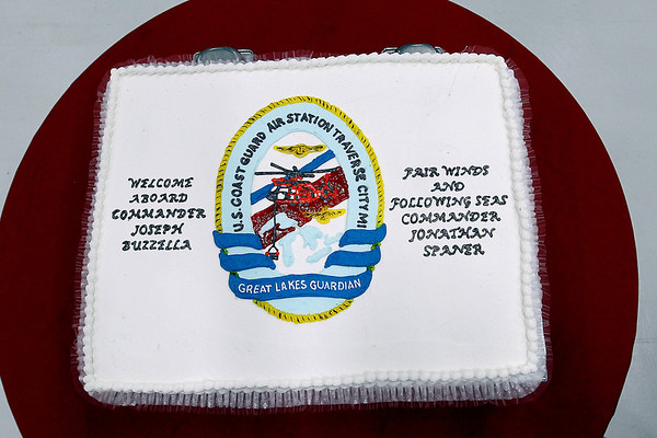 Record-Eagle/Jan-Michael Stump<br /> A cake waits for guests at the Change of Command Ceremony as Cmdr Joseph Buzzella, Jr. relieves Cmdr Jonathan Spaner as head of U.S. Coast Guard Air Station Traverse City Friday in the station's hanger.