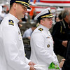 Record-Eagle/Jan-Michael Stump<br /> Cmdr Joseph Buzzella, Jr., left, and Cmdr Jonathan Spaner greet guests after Buzzella relieved Spanner as head of U.S. Coast Guard Air Station Traverse City during Friday's Change of Command ceremony.