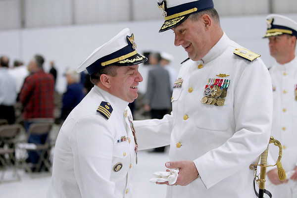 Record-Eagle/Jan-Michael Stump<br /> Cmdr Jonathan Spaner, left, and Read Admiral Michael Parks laugh following Friday's Change of Command ceremony at U.S. Coast Guard Air Station Traverse City.