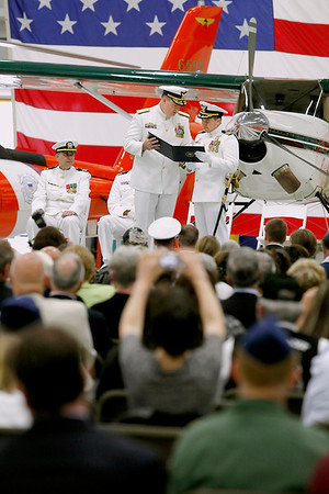 Record-Eagle/Jan-Michael Stump<br /> Rear Admiral Michael Parks, left, awards Cmdr Jonathan Spaner during Friday's Change of Command Ceremony at U.S. Coast Guard Air Station Traverse City.