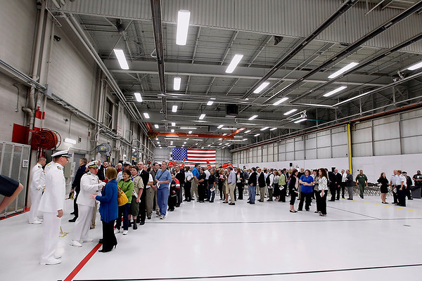 Record-Eagle/Jan-Michael Stump<br /> A line of people waiting to greet Cmdr Joseph Buzzella, Jr. and Cmdr Jonathan Spaner winds through the hangar at Air Station Traverse City following Friday's Change of Command Ceremony.