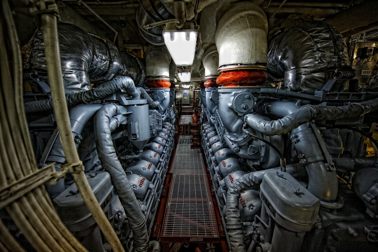 This is what a 50,000 horsepower engine room looks like.  The two diesel engines were built by German engine manufacturer MTU Systems & Engineering.  The turbine is behind the far wall.  Both engines and the turbine can be engaged simultaneously.