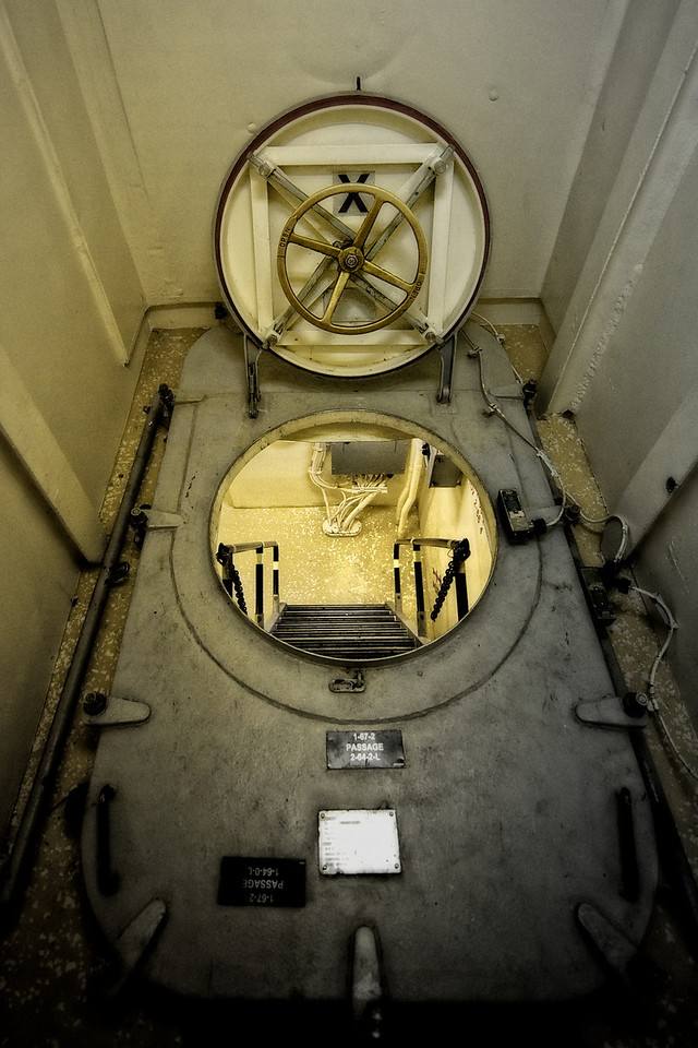 "Sponsor Sail, USCGC Waesche<br /> <br /> Before we enter the (basically spotless) engine room, I want to apologize in advance to Tony Erickson, the Engineering Officer of the Waesche.  I have deliberately added grunge to the images from the hatch above through the entire engine room series.  This added grunge helps to convey the intensity of the feeling when inside the bowels of the ship, with the engine operating around us, the propeller shafts spinning through the center of the entire room, and the overall ""machineness"" of the place."