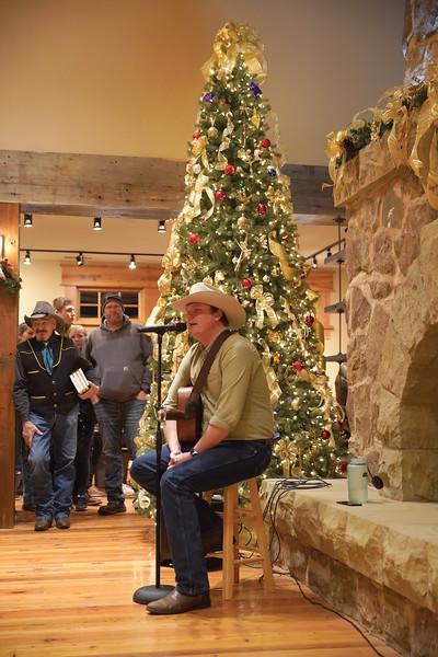 Matthew Gaston | The Sheridan Press<br>Taylor Corum performs original music during the Ucross Community Christmas Saturday, Dec. 14, 2019.
