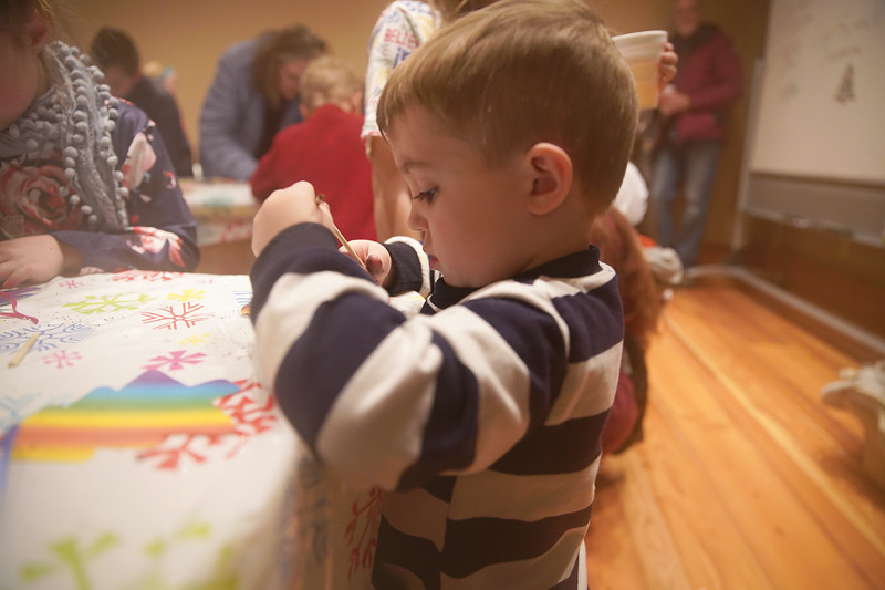 Matthew Gaston | The Sheridan Press<br>Three-year-old Charlie Cooley makes a Christmas tree ornament during the Ucross Community Christmas Saturday, Dec. 14, 2019.