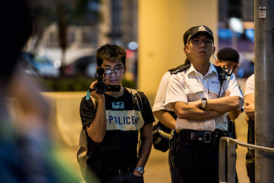 Police officers record the activities at an event commemorating the 4th anniversary of the Umbrella Revolution in Hong Kong on September 28, 2018.