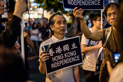 Demonstrators hold up signs in support of Hong Kong independence at an event commemorating the 4th anniversary of the Umbrella Revolution in Hong Kong on September 28, 2018.