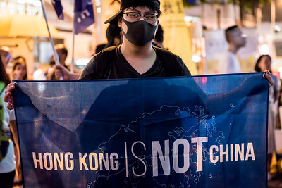 A demonstrator hold up a sign declaring that Hong Kong is not part of China at an event commemorating the 4th anniversary of the Umbrella Revolution in Hong Kong on September 28, 2018.