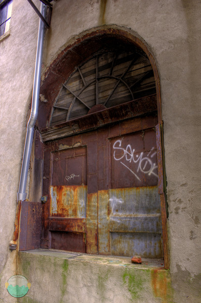 Gerke Elevator<br /> The door that they used to use to enter Gerke Brewery's lagering tunnels to an elevator shaft that took the lager beer to the chilly temp below the street.  The beer was brewed across the way and rolled to here to be stored under another building.