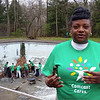 Gayle Young, executive director of the United Way of Lawrence County, talks about the agencies plans to resurrect the Cascade Park pool while volunteers work to remove leaves in what was the 12-foot diving well section of the pool.