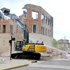 Beckley public works working on demolishing the last of the building destroyed in the Jan. 2 Uptown fire on Saturday. Photo by Chris Tilley/ The Register-Herald