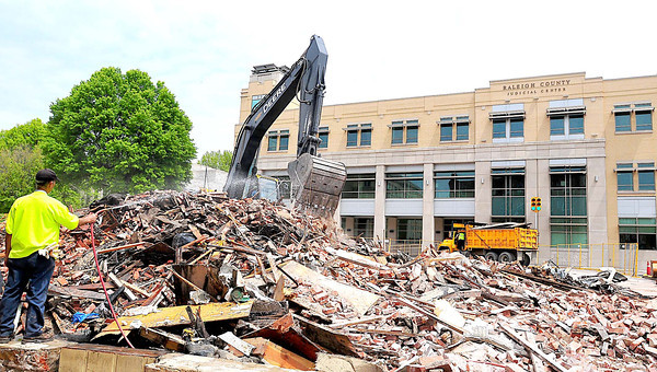 Beckley public works working on demolishing the last of the buildings destroyed in the Jan. 2 Uptown fire on Sunday. Photo by Chris Tilley/ The Register-Herald