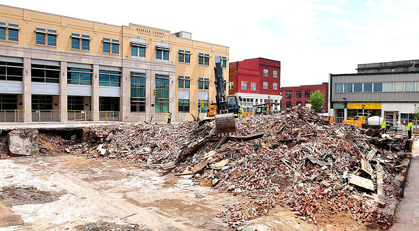 Beckley public works, working on demolishing the last of the buildings destroyed in the Jan. 2 Uptown fire on Sunday. Photo by Chris Tilley/ The Register-Herald