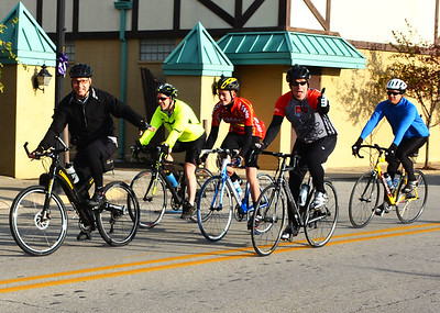 "Debbie Blank | The Herald-Tribune Batesville resident Bill Flannery was leading the pack of about 25 cyclists who took part in Vélo in the Ville's rides along four routes Saturday. He and friends rode 24 miles in an hour and 45 minutes. They enjoyed water and bananas at the Ertel Cellars Winery sag stop. ""It was chilly and very windy."" Please see more photos on page 5."