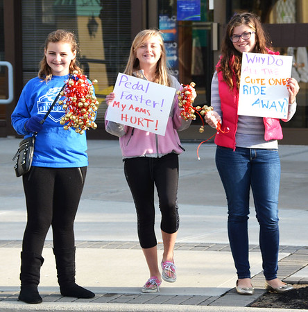 Debbie Blank | The Herald-Tribune Mayor's Youth Council members cheered on the cyclists in downtown Batesville, giving the event a bit of Tour de France atmosphere.
