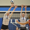 Norfolk Daily News/AaronBeckman  <br /> <br /> Pierce's Maggie Brahmer (8) and Sidney Zimmerer(7) go up to block a spike from a Norfolk Catholic player Thursday night in Pierce.