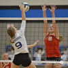 Norfolk Daily News/Aaron Beckman  <br /> <br /> Norfolk Catholic's Abby Miller (15) goes up to block a spike from Pierce's Meredith Fasse (9) Thursday night in Pierce.