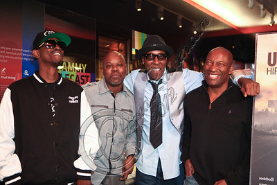 "LOS ANGELES, CA - APRIL 26:  (L-R) Rapper Kurupt, rapper Too Short, actor/comedian Arsenio Hall and director John Singleton attend the ""Uprising"" screening and panel discussion at at The GRAMMY Museum on April 26, 2012 in Los Angeles, California.  (Photo by Chelsea Lauren/WireImage)"