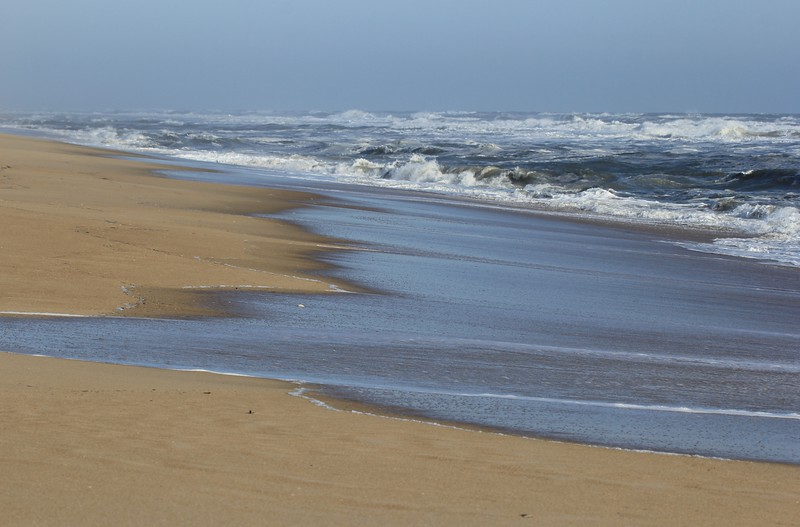 Not a soul on the beach, choppy ocean, blue skies, even the birds were hunkered down somewhere!