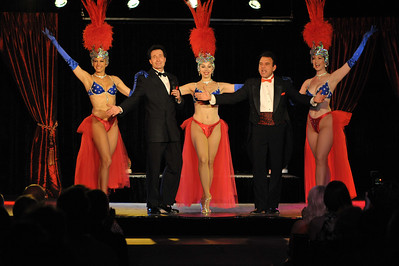 Vegas The Show live performance photo of the show Tony Sacca created, produced and directed which is a history of Vegas with humor and a story in songs and vintage Vegas film footage from early 1900's to the present. Vegas The Show stars Tony Sacca, Tom Wallek and 3 Show Girl dancer singers and can be seen in the Embassy Theater at Las Vegas Rocks Cafe. Tickets and reservations at www.LasVegasRocksCafe.com or call (702) 227-5872.  Photograph by Mark Bowers s Copyright 2010 All Rights Reserved