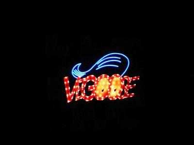 The neon pompadour of Vegoose.