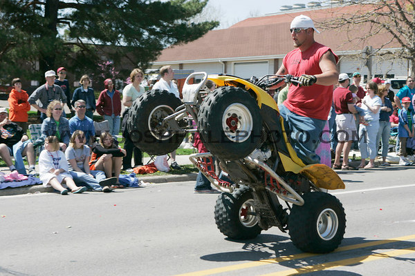 A member of the ISU Motocross Club rides for the crowd during the 2006 Veishea Parade on Saturday, April 22, 2006.