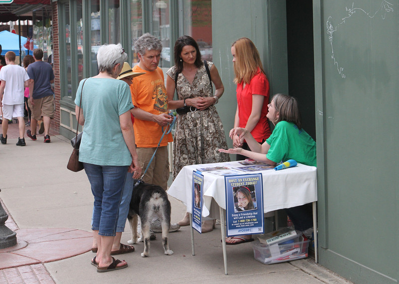 On the street is a convenient place to get your questions about hosting an exchange student answered.