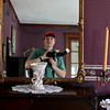 Self portrait in the parlor mirror by and of the photojournalist for the day's Syttende Mai celebration -Kent Sweitzer
