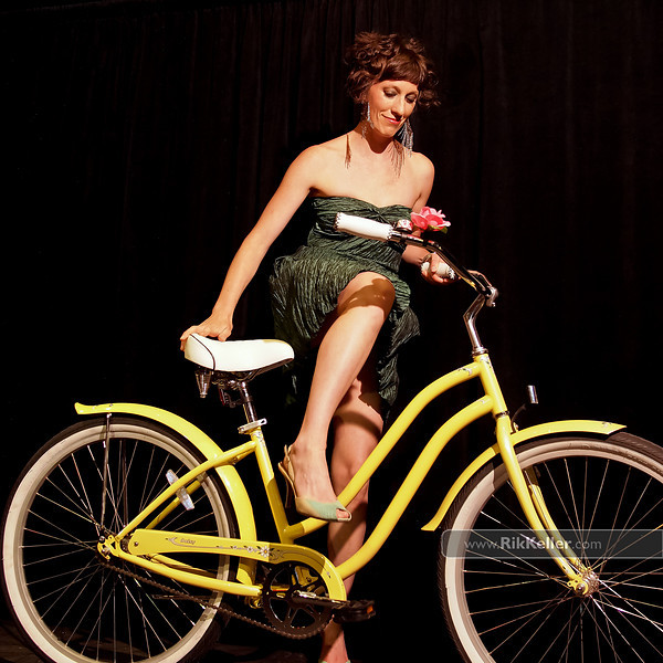 P5075218<br /> Tricia Hedahl - night look while elegantly mounting a Phat cruiser bike from City Bicycle Works