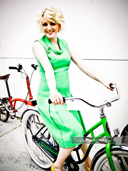 P5075065<br /> Skylar Mundy before the show with a green vintage dress from Cuff's and a matching green Schwinn from College Cyclery