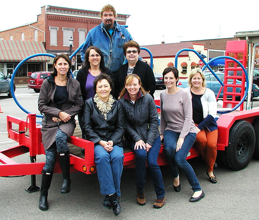 Debbie Blank | The Herald-Tribune<br /> Bob Maple of Red Forge Weld & Fabrication Shop, Morris, created a blue bike rack that will be placed in the small future park. The Rural Alliance for the Arts purchased the rack to donate to the city. With him are (front row from left) RAA executive director Joan Kuhlman and board members Kathleen Bohman, Jen Saner, Carla Austin; (back row) Anne Raver, Judy Meyer and Linda Tuttle.