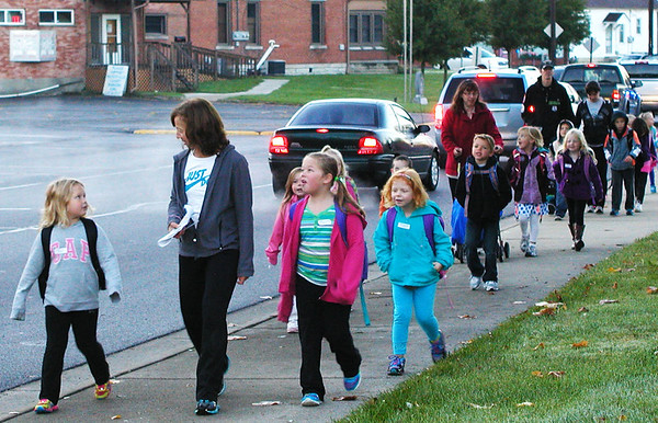 Diane Raver | The Herald-Tribune Over 350 kids, as well as some school administrators, teachers and parents, walked from Liberty Park to their schools.
