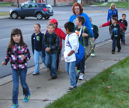 Diane Raver | The Herald-Tribune<br /> Students, parents and school staff members seemed to enjoy the fresh air on the way to school.