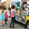 Debbie Blank | The Herald-Tribune<br /> Jen Saner, Batesville, buys treats for her daughters from the Biker Dude Ice Cream truck after the group photo.