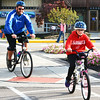 Debbie Blank | The Herald-Tribune<br /> Batesville resident Andy Saner and a daughter take to a sidewalk in downtown Batesville.