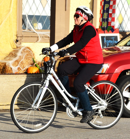 Debbie Blank | The Herald-Tribune<br /> Batesville resident Joan Kuhlman glides past the Sherman House with a cap, gloves, vest and knee socks providing needed warmth.
