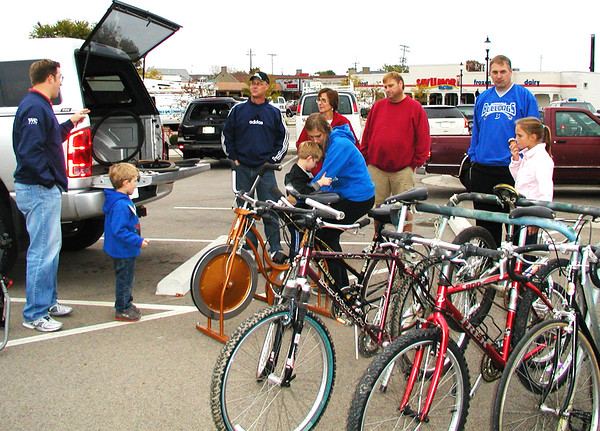 Debbie Blank | The Herald-Tribune<br /> Dale Freese (third from left), Batesville, was at Vélo in the Ville: Get Psyched About Bikes Oct. 9 event to try and sell extra bikes the family had accumulated.