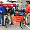 Debbie Blank | The Herald-Tribune<br /> Ian Dickey (center), 14, checks out a bike Andy Gutzwiller (left) is trying to sell as Ron Decker watches.