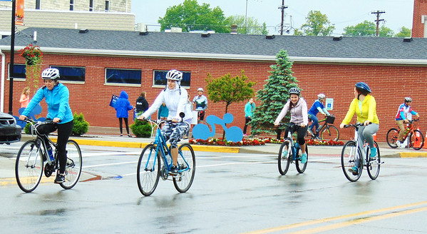 Debbie Blank   The Herald-Tribune Four females head north on Main Street at the start of the rides.
