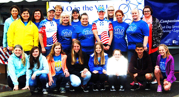 Debbie Blank   The Herald-Tribune Liz Kellerman (standing fifth from right), one of Vélo in the Ville's founders and St. Andrews Health Campus community service representative, is surrounded by other volunteers. In addition to St. Andrews, the May 21 event was sponsored by the city, Batesville Main Street, Batesville Area Chamber of Commerce, Southeastern Indiana YMCA, Margaret Mary Health and its foundation, where proceeds will be given.