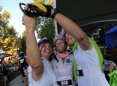 Laura Arbury, left, Leanne Jeffers and Jennifer Coken, document their race day with a photo before the 67-mile ride wave. The third annual Venus de Miles bike ride had hundreds of women participants leaving from Prospect Park in Longmont.The ride benefits the Greenhouse Scholars, a local non-profit for that provides scholarships to college students.  For more photos and a video of Venus de Miles, go to www.dailycamera.com. Cliff Grassmick / August 29, 2010