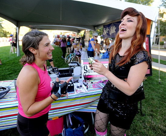 """Rider, Nichole Didelot, left,  and Janie, of Sugar Mill Production, share a laugh after she was made up for the ride.<br /> The third annual Venus de Miles bike ride had hundreds of women participants leaving from Tenacity Park in the Prospect area of Longmont.<br />  For more photos and a video of Venus de Miles, go to  <a href=""""http://www.dailycamera.com"""">http://www.dailycamera.com</a>.<br /> Cliff Grassmick / August 29, 2010"""