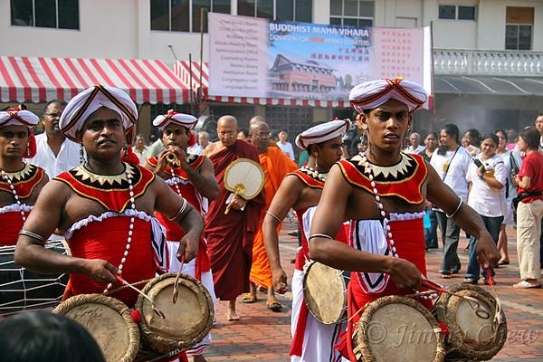 Sri Lankan cultural dancers escorting Chief Monk Venerable K. Sri Dhammaratana Nayaka Thero to the stage.