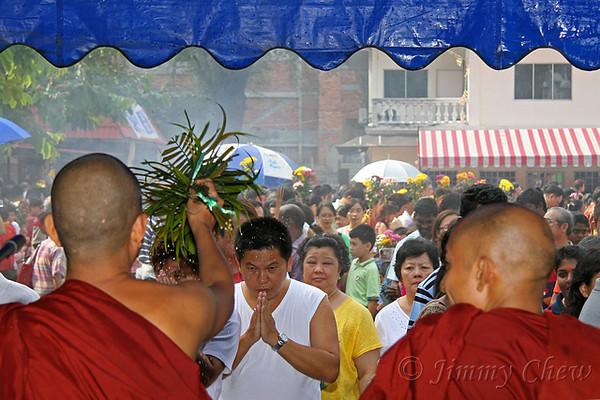 Devotees getting blessed from monks.