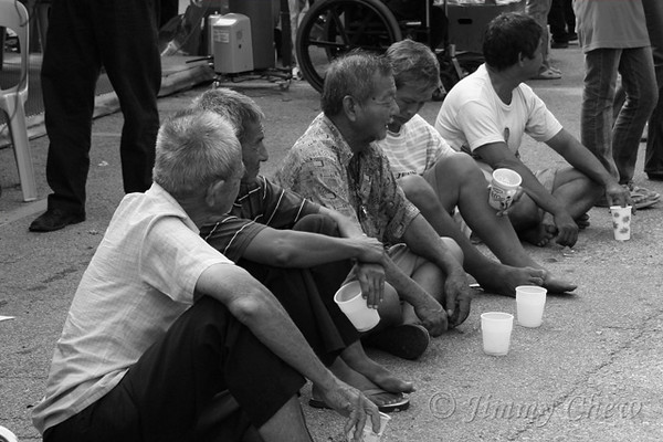 Seeking donations along Jalan Berhala.