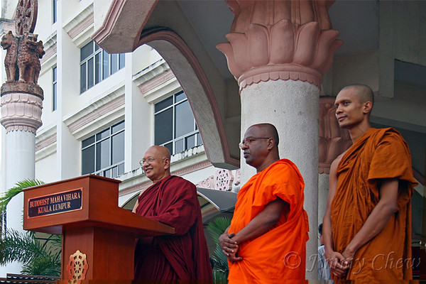 Venerable K. Sri Dhammaratana Nayaka Thero delivering a silent prayer request.