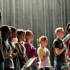 "Record-Eagle/Jan-Michael Stump<br /> Members of the Elk Rapids High School marching band stand for the ""Star Spangled Banner,"" at the start of Wednesday's school assembly, in which Lt. Col. Sam Pfeiffer, USMC retired, presented an American flag flown in Iraq as a gift from Army Chief Warrant Officer Brandon Stites, a 1991 Elk Rapids grad currently serving in Iraq."