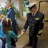 Record-Eagle/Keith King<br /> Brittany Sprick, a fourth-grade student at Mill Creek Elementary School in Williamsburg, thanks United States Navy veteran, Jim Buckler, of Rapid City, Thursday, November 11, 2010.