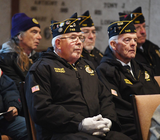 WARREN  DILLAWAY | Star Beacon <br /> Members of North Kingsville American Legion Neal Post 743 listen to the main speaker at a Vetrans Day program on Monday afternoon at the Greenlawn Memory Gardens Mausoleum in North Kingsville.