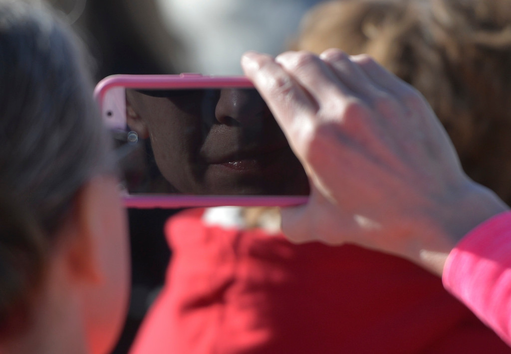 Justin Sheely | The Sheridan Press<br /> A woman records video on her phone during the Veterans Day ceremony Friday at the Sheridan College Veterans Plaza.